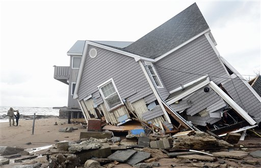 <div class='meta'><div class='origin-logo' data-origin='none'></div><span class='caption-text' data-credit='AP'>People stand next to a house collapsed from superstorm Sandy in East Haven, Conn. on Tuesday, Oct. 30, 2012. (AP Photo/Jessica Hill)</span></div>