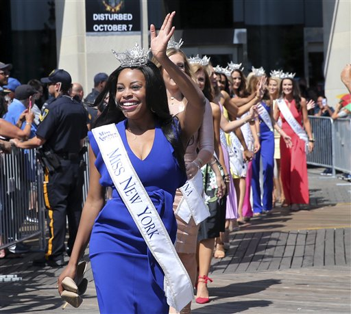<div class='meta'><div class='origin-logo' data-origin='none'></div><span class='caption-text' data-credit='AP'>Miss New York, Camille Sims waves as she is introduced during Miss America Pageant arrival ceremonies Tuesday, Aug. 30, 2016, in Atlantic City.</span></div>