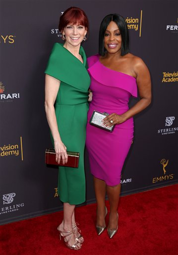 "<div class=""meta image-caption""><div class=""origin-logo origin-image ap""><span>AP</span></div><span class=""caption-text"">Carrie Preston, left, and Niecy Nash arrive at the Television Academy's Performers Emmy Celebration at the Montage Beverly Hills on Monday, Aug. 22, 2016. (Invision for the Television Academy)</span></div>"