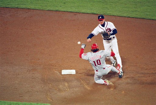 <div class='meta'><div class='origin-logo' data-origin='AP'></div><span class='caption-text' data-credit='Associated Press'>Darren Daulton is seen sliding into second during Game 4 of the NLCS on Oct. 10, 1993.</span></div>