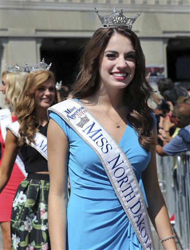 <div class='meta'><div class='origin-logo' data-origin='none'></div><span class='caption-text' data-credit='AP'>Miss North Dakota, Macy Christianson is introduced during Miss America Pageant arrival ceremonies Tuesday, Aug. 30, 2016, in Atlantic City.</span></div>