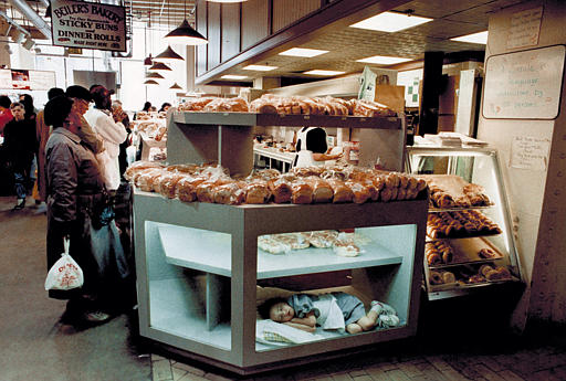 <div class='meta'><div class='origin-logo' data-origin='none'></div><span class='caption-text' data-credit=''>Ann Crystal Beiler, 5, of Intercourse, Pa., takes a nap in the display case of her father's bakery at the Reading Terminal Market in Philadelphia, March 26, 1994.  (AP Photo/Amy Sa</span></div>