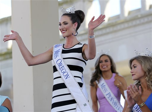 <div class='meta'><div class='origin-logo' data-origin='none'></div><span class='caption-text' data-credit='AP'>Miss Oregon, Alexis Mather waves as she is introduced during Miss America Pageant arrival ceremonies Tuesday, Aug. 30, 2016, in Atlantic City.</span></div>