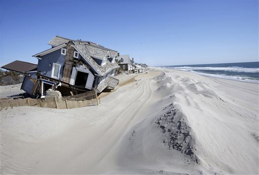 <div class='meta'><div class='origin-logo' data-origin='none'></div><span class='caption-text' data-credit='AP'>Homes severely damaged by Superstorm Sandy, are seen along the beach Thursday, April 25, 2013, in Mantoloking, N.J.</span></div>