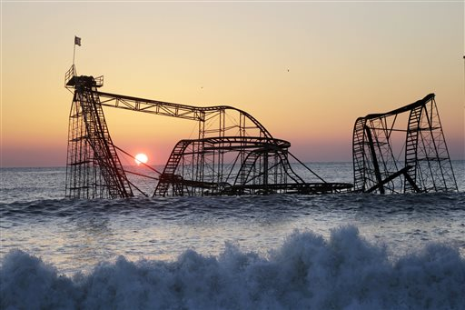 <div class='meta'><div class='origin-logo' data-origin='none'></div><span class='caption-text' data-credit='AP'>In a Feb. 25, 2013 file photo, the sun rises in Seaside Heights, N.J., behind the Jet Star Roller Coaster</span></div>