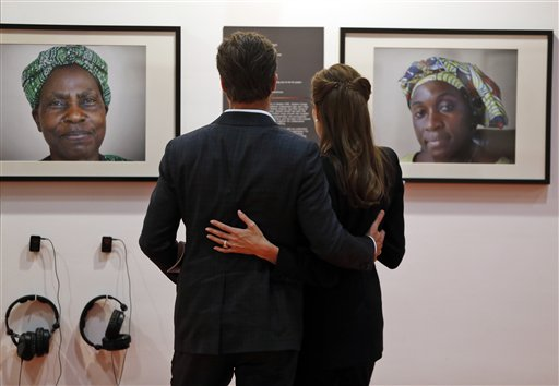 "<div class=""meta image-caption""><div class=""origin-logo origin-image none""><span>none</span></div><span class=""caption-text"">Angelina Jolie embraces her partner Brad Pitt as they view photographs of Zawadi Nikuze (AP Photo/Lefteris Pitarakis, pool) (AP)</span></div>"