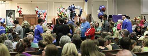 <div class='meta'><div class='origin-logo' data-origin='none'></div><span class='caption-text' data-credit='Ken Ruinard/The Independent-Mail via AP, Pool'>Friends and family line up during a wake service for Jacob Hall at Oakdale Baptist Church in Townville, S.C., Wednesday, Oct. 4, 2016.</span></div>