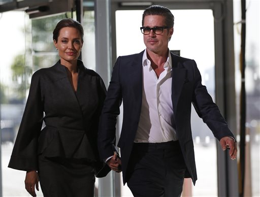 "<div class=""meta image-caption""><div class=""origin-logo origin-image none""><span>none</span></div><span class=""caption-text"">In this Friday, June 13, 2014, file photo, Angelina Jolie and Brad Pitt arrive at the ""End Sexual Violence in Conflict"" summit in London (AP Photo/Lefteris Pitarakis, File) (AP)</span></div>"