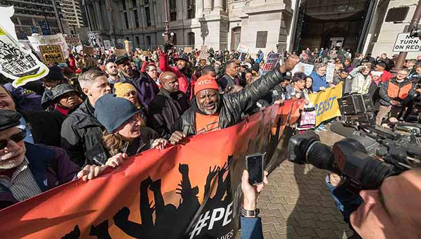 <div class='meta'><div class='origin-logo' data-origin='WPVI'></div><span class='caption-text' data-credit='Action News photographer Bruce Neumann'>Protesters greeted Donald Trump as he arrived in Philadelphia to address the GOP retreat.</span></div>