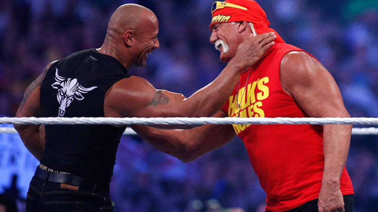 Dwayne Johnson aka The Rock, left, embraces Hulk Hogan during Wrestlemania XXX at the Mercedes-Benz Super Dome in New Orleans.