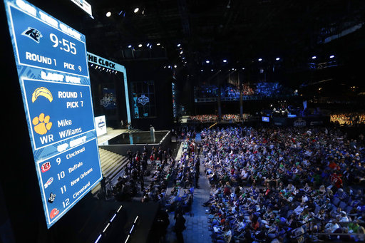 <div class='meta'><div class='origin-logo' data-origin='AP'></div><span class='caption-text' data-credit='AP'>Fans watch as the Carolina Panthers are on the clock for their selection during the first round of the 2017 NFL football draft (AP Photo/Julio Cortez)</span></div>