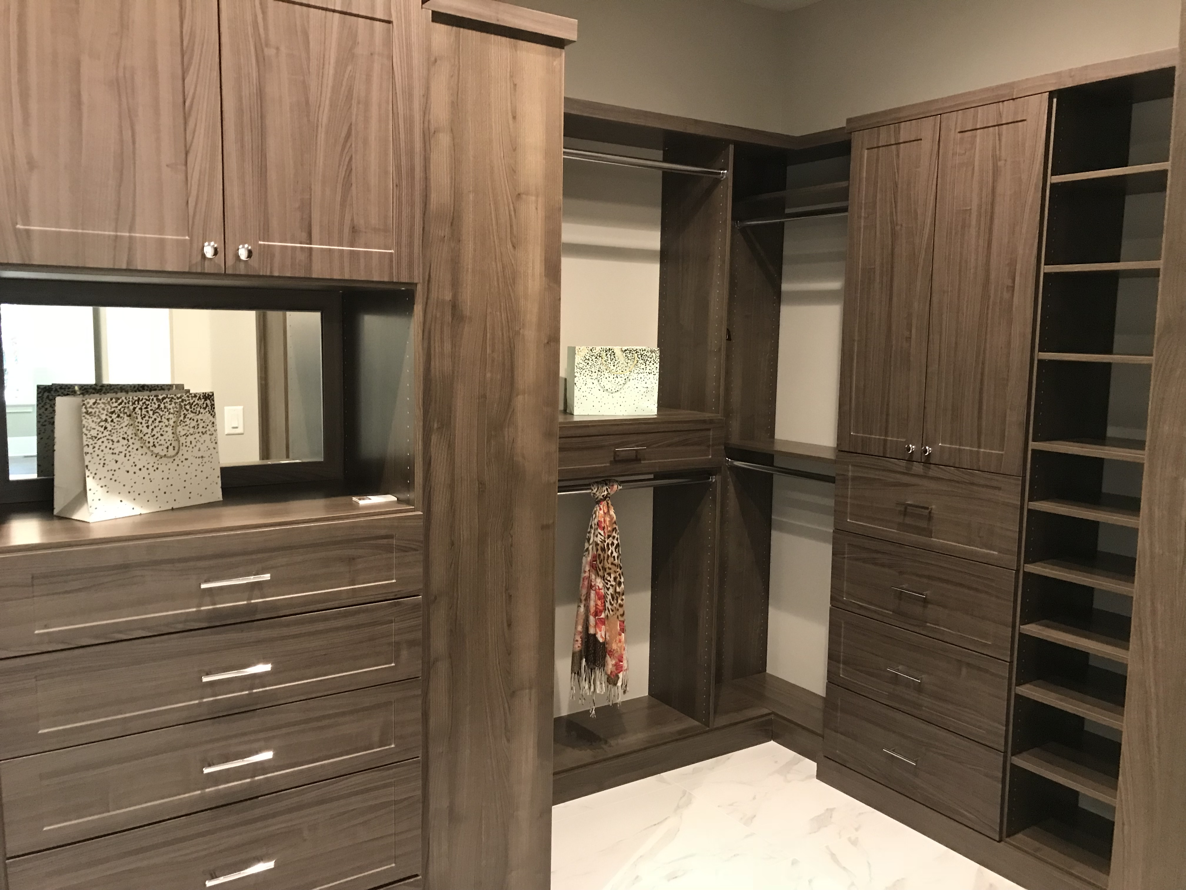 <div class='meta'><div class='origin-logo' data-origin='none'></div><span class='caption-text' data-credit='WTVD photo/Shawn Replogle'>Master closet - 6506 New Market Way, Raleigh, NC - $1.25 million by Raleigh Custom Homes</span></div>