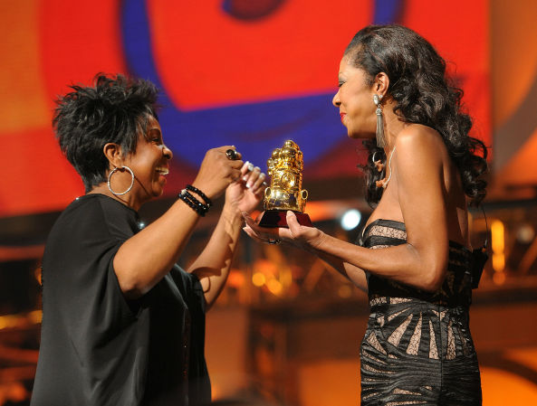 "<div class=""meta image-caption""><div class=""origin-logo origin-image none""><span>none</span></div><span class=""caption-text"">Singer Natalie Cole presents Gladys Knight with the Legend Award on Centric's 3rd Annual Soul Train Awards in 2011 in Atlanta. (AP photo/ Frank Micelotta)</span></div>"