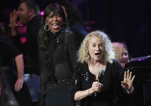 "<div class=""meta image-caption""><div class=""origin-logo origin-image none""><span>none</span></div><span class=""caption-text"">Singer Carole King, right, is joined by Natalie Cole at the SeriousFun Children's Network, May 14, 2015, in Los Angeles.  (AP Photo/Chris Pizzello)</span></div>"