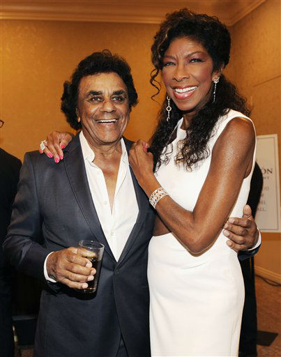 "<div class=""meta image-caption""><div class=""origin-logo origin-image none""><span>none</span></div><span class=""caption-text"">Singers Johnny Mathis, left, and Natalie Cole pose together at the 2014 Carousel of Hope Ball at the Beverly Hilton Hotel on Saturday, Oct. 11, 2014. (AP photo/Chris Pizzello)</span></div>"