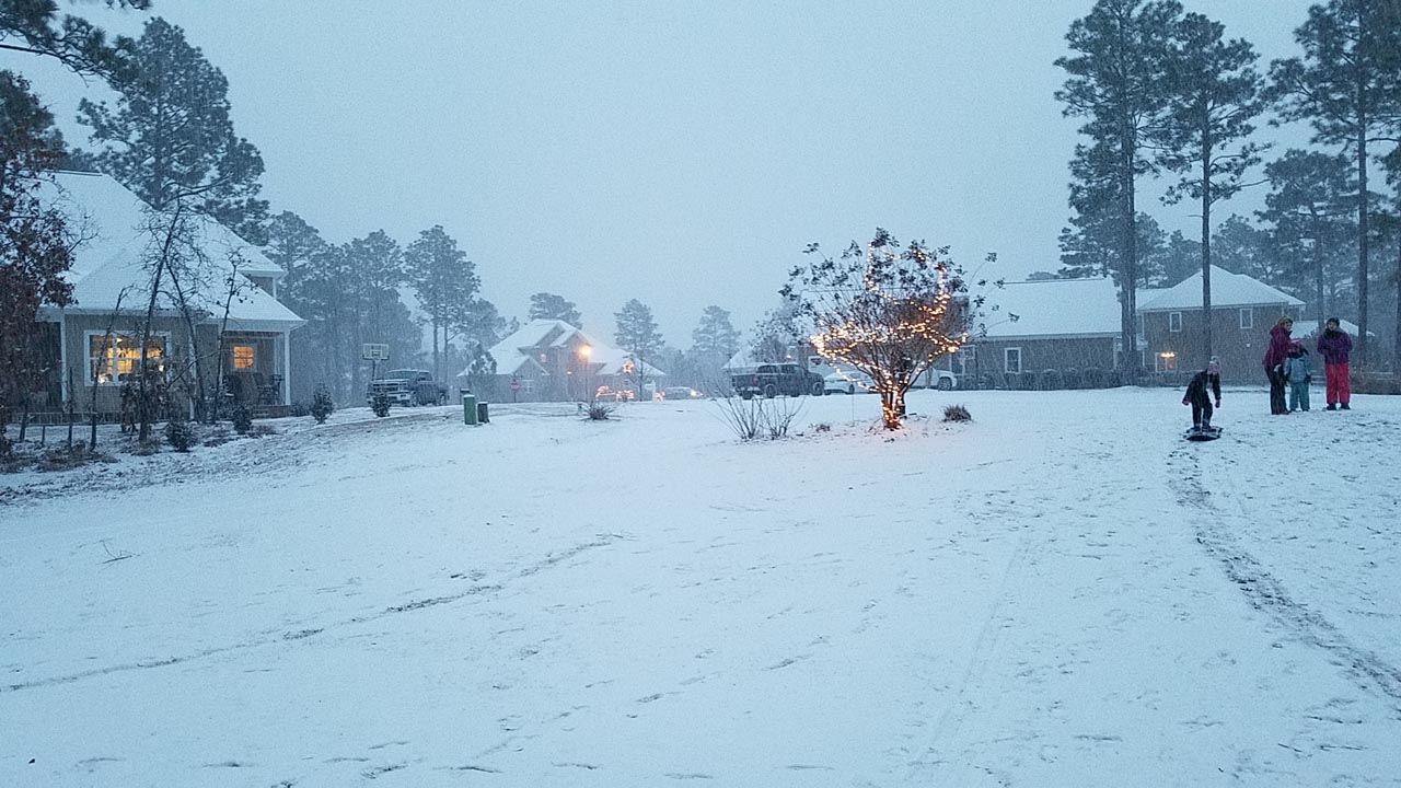 <div class='meta'><div class='origin-logo' data-origin='none'></div><span class='caption-text' data-credit='Amy Bryant - ABC11 Eyewitness'>Snow in Whispering Pines</span></div>