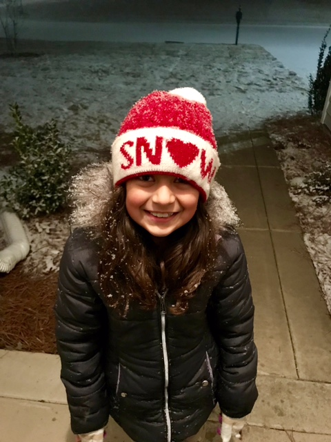 <div class='meta'><div class='origin-logo' data-origin='none'></div><span class='caption-text' data-credit='Lissett Lopez - ABC11 Eyewitness'>Daughter Analise seeing  the snow fall early evening in Fayetteville.</span></div>