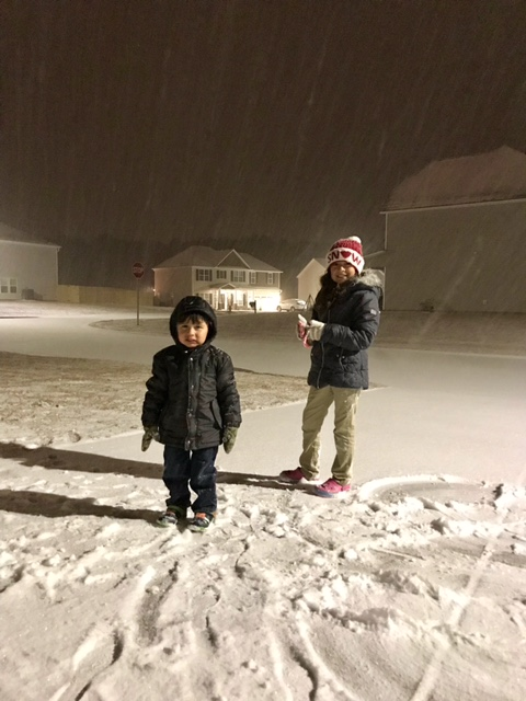 <div class='meta'><div class='origin-logo' data-origin='none'></div><span class='caption-text' data-credit='Lissett Lopez - ABC11 Eyewitness'>Under the snow fall. Ayden and Analise Lopez. Cumberland County.</span></div>