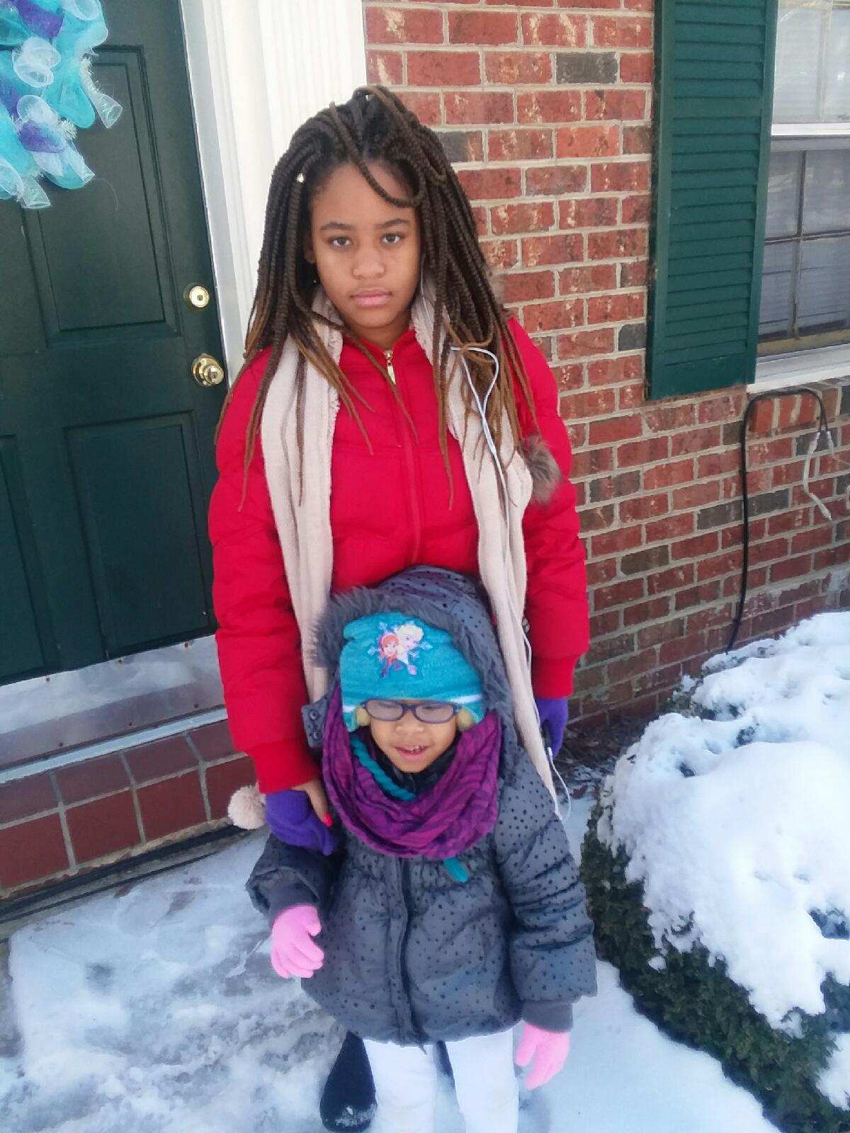 <div class='meta'><div class='origin-logo' data-origin='none'></div><span class='caption-text' data-credit='Regina Emerson - ABC11 Eyewitness'>Jasney Emerson and Kinley Howard enjoying sister love on their snow-day off.</span></div>