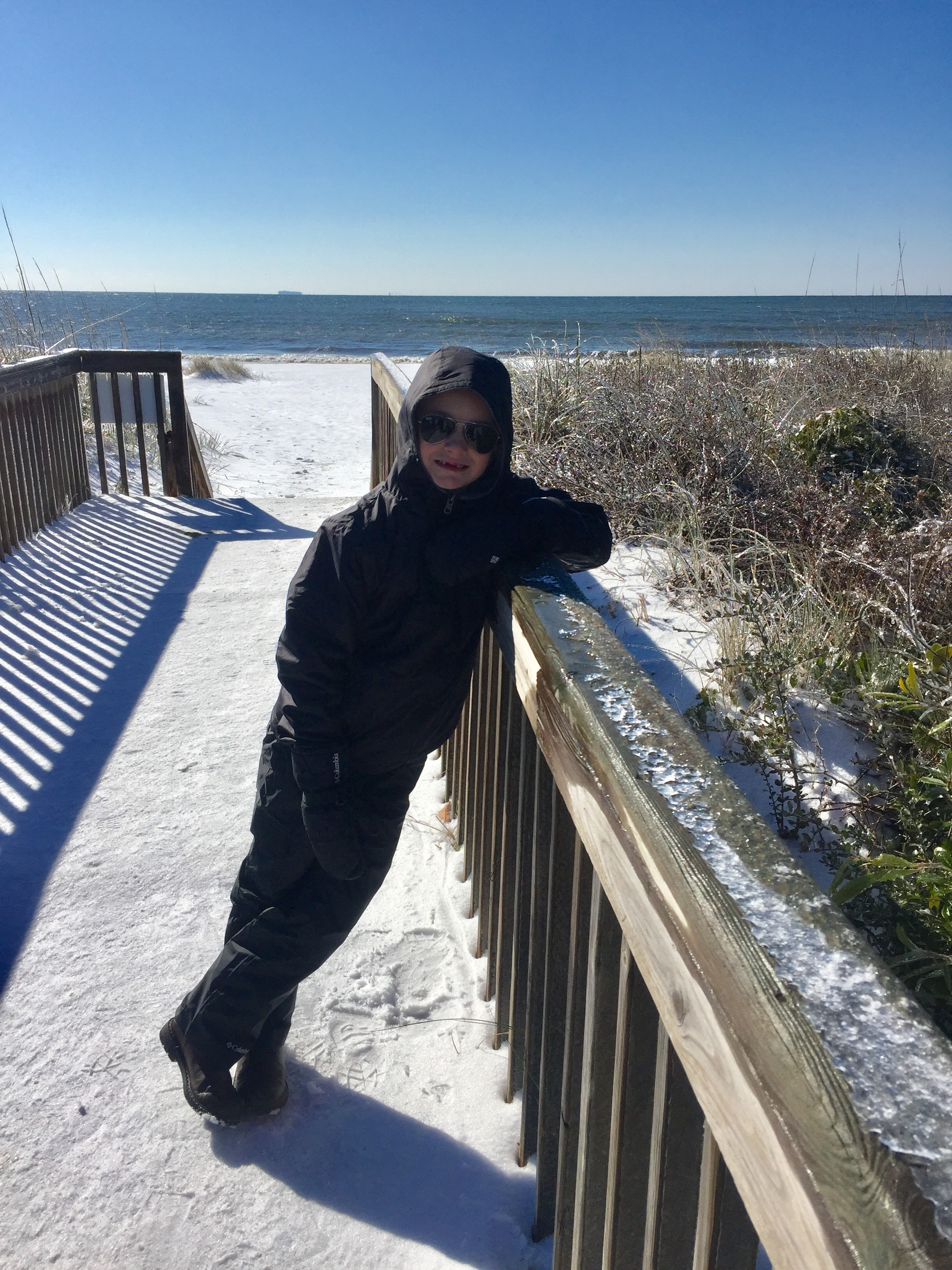 <div class='meta'><div class='origin-logo' data-origin='none'></div><span class='caption-text' data-credit='Michelle Mena - ABC11 Eyewitness'>Max Mena, 6, enjoys snow at the beach at Caswell on Oak Island!</span></div>