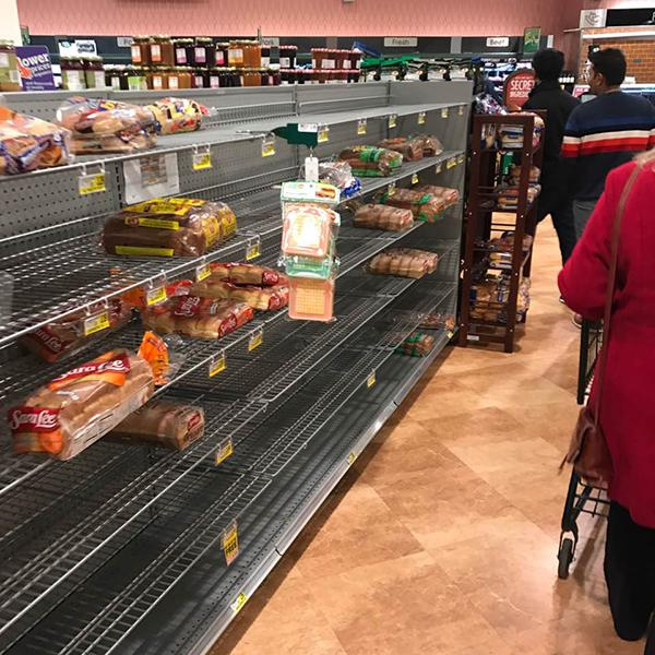"<div class=""meta image-caption""><div class=""origin-logo origin-image wtvd""><span>WTVD</span></div><span class=""caption-text"">The milk and bread line was so long at 8:30 p.m. Thursday at Harris Teeter in Cary that it wrapped around to the dairy section. (Randy/ABC11 Eyewitness)</span></div>"