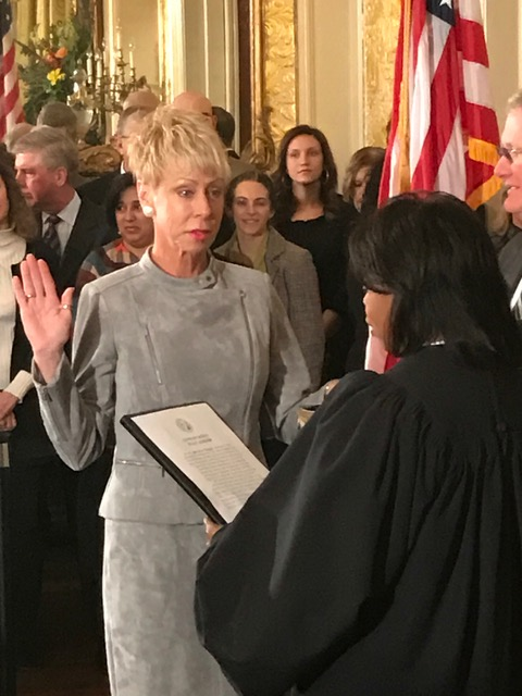 <div class='meta'><div class='origin-logo' data-origin='none'></div><span class='caption-text' data-credit=''>Beth Wood takes the oath.</span></div>
