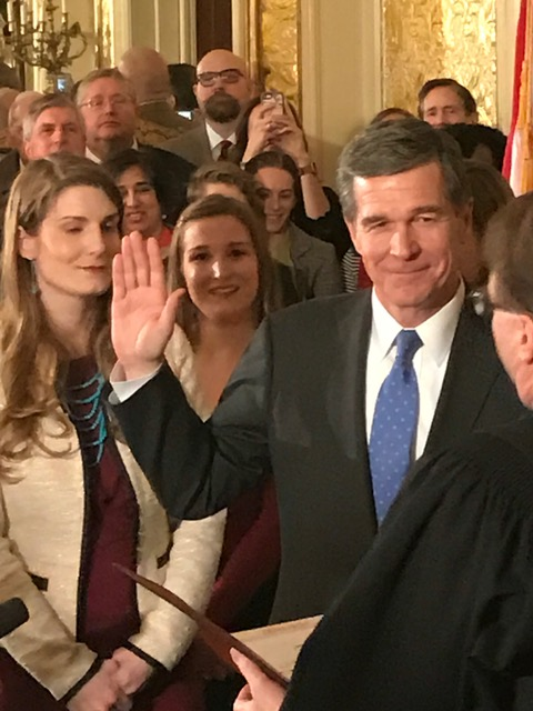 <div class='meta'><div class='origin-logo' data-origin='none'></div><span class='caption-text' data-credit=''>Governor Roy Cooper takes the oath</span></div>