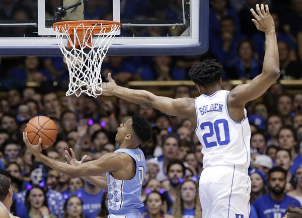 <div class='meta'><div class='origin-logo' data-origin='AP'></div><span class='caption-text' data-credit='Gerry Broome'>North Carolina's Nate Britt (0) drives to the basket as Duke's Marques Bolden (20) defends.</span></div>