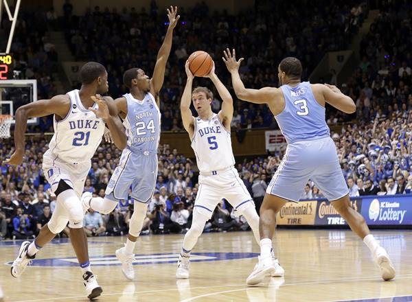 "<div class=""meta image-caption""><div class=""origin-logo origin-image ap""><span>AP</span></div><span class=""caption-text"">Duke's Luke Kennard (5) looks to pass as Amile Jefferson (21) looks for the ball while North Carolina's Kenny Williams (24) and Kennedy Meeks (3) defend. (Gerry Broome)</span></div>"