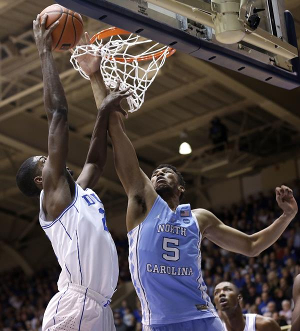 <div class='meta'><div class='origin-logo' data-origin='AP'></div><span class='caption-text' data-credit='Gerry Broome'>North Carolina's Tony Bradley (5) defends while Duke's Amile Jefferson drives to the basket .</span></div>