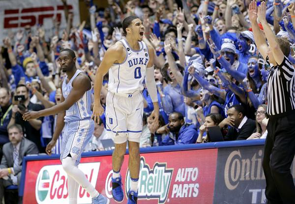 "<div class=""meta image-caption""><div class=""origin-logo origin-image ap""><span>AP</span></div><span class=""caption-text"">Duke's Jayson Tatum (0) celebrates following a 3-point basket as North Carolina's Theo Pinson (1) watches. (Gerry Broome)</span></div>"
