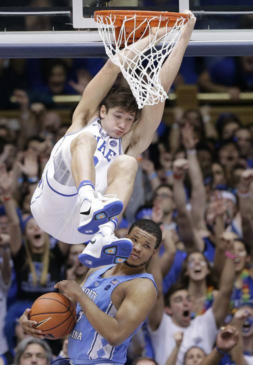 "<div class=""meta image-caption""><div class=""origin-logo origin-image ap""><span>AP</span></div><span class=""caption-text"">Duke's Grayson Allen hangs from the rim after a dunk as North Carolina's Kennedy Meeks (3) catches the ball. (Gerry Broome)</span></div>"