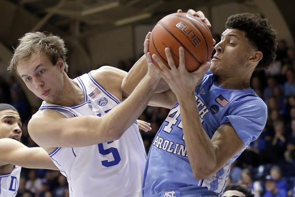 <div class='meta'><div class='origin-logo' data-origin='AP'></div><span class='caption-text' data-credit='Gerry Broome'>Duke's Luke Kennard (5) and North Carolina's Justin Jackson struggle for possession.</span></div>