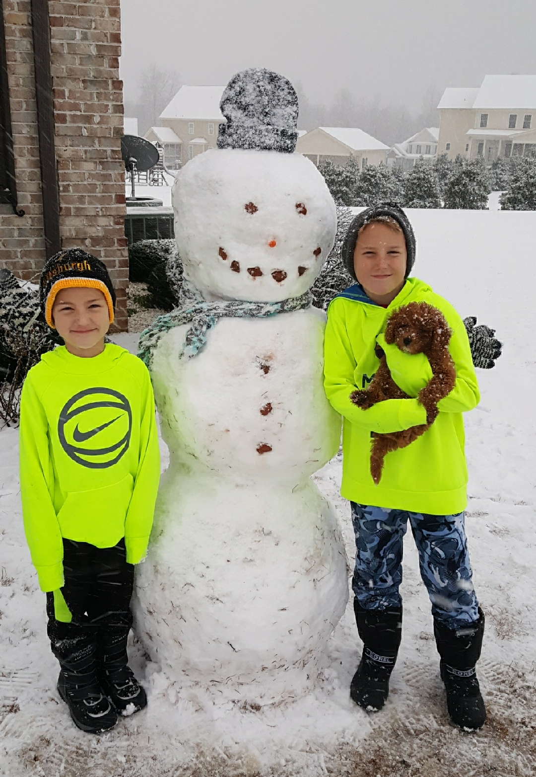 "<div class=""meta image-caption""><div class=""origin-logo origin-image wtvd""><span>WTVD</span></div><span class=""caption-text"">Our grandsons and their new puppy (Gracey) enjoying the new fallen snow. (Jerome Nashadka - ABC11 Eyewitness)</span></div>"