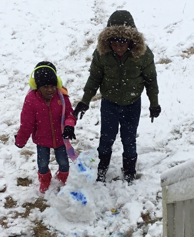 "<div class=""meta image-caption""><div class=""origin-logo origin-image wtvd""><span>WTVD</span></div><span class=""caption-text"">Serenity and Skyy Henderson enjoying their snow day in Henderson. Let it snow! (Sharmel Henderson - ABC11 Eyewitness)</span></div>"