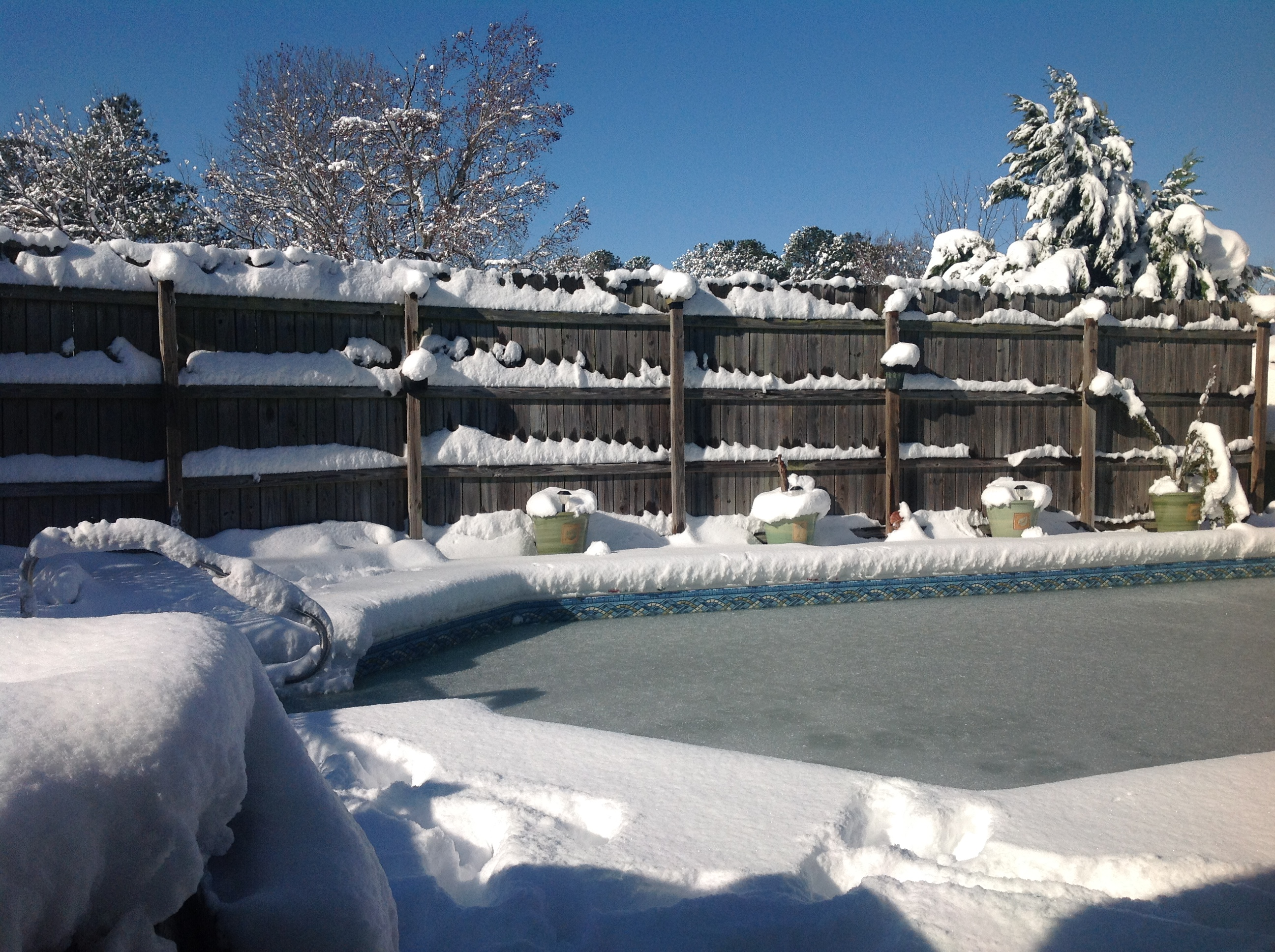 <div class='meta'><div class='origin-logo' data-origin='WTVD'></div><span class='caption-text' data-credit='Linda from Durham - ABC11 Eyewitness'>No swimming for a while - 8 inches of snow in Durham!</span></div>
