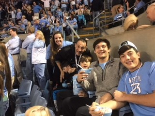 <div class='meta'><div class='origin-logo' data-origin='none'></div><span class='caption-text' data-credit='Credit: Fill Your Bucket List Foundation'>Anthony Leonard and his family watching the big game</span></div>