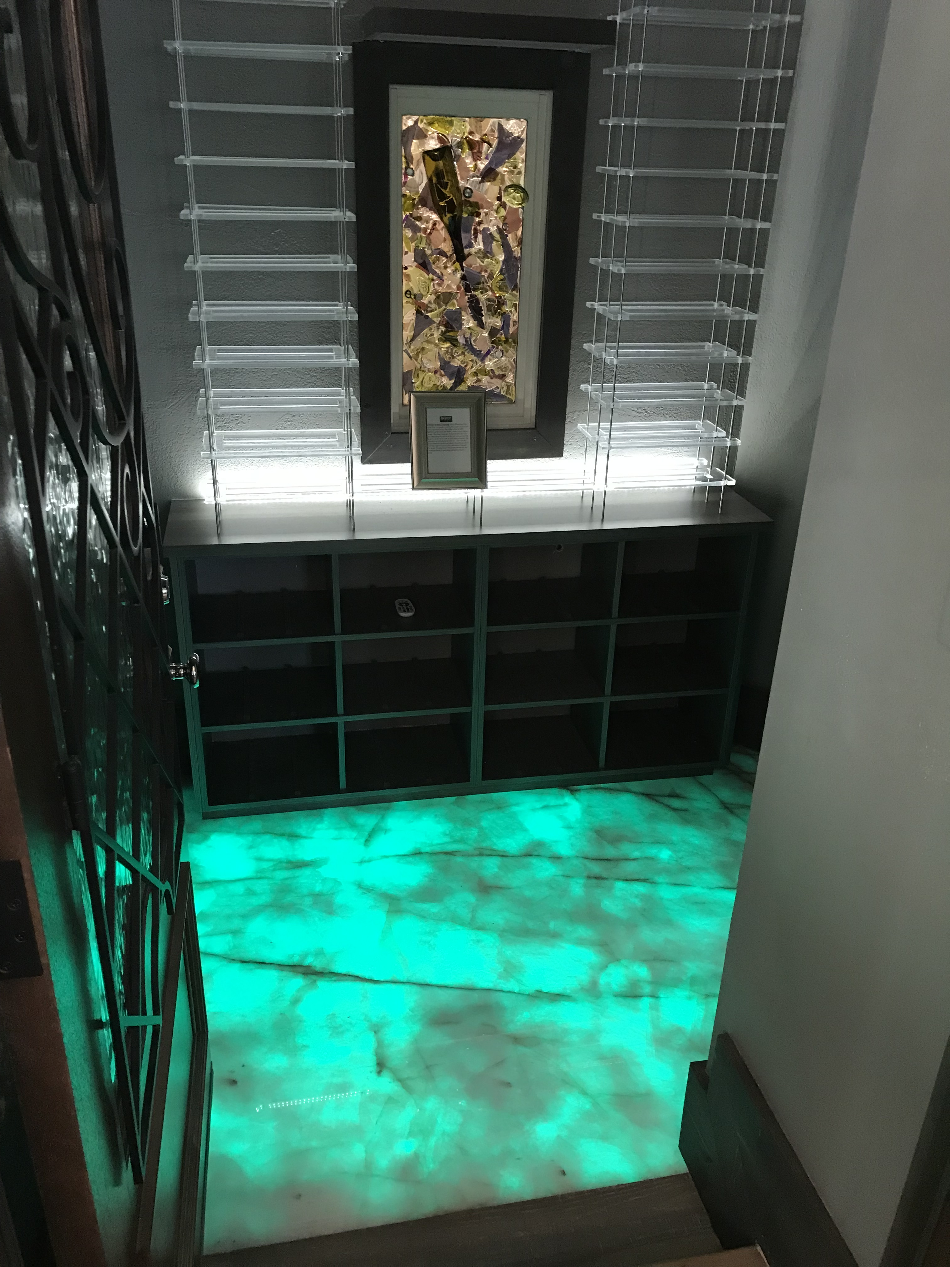 <div class='meta'><div class='origin-logo' data-origin='none'></div><span class='caption-text' data-credit='WTVD Photo/Shawn Replogle'>Wine cellar floor changes colors - 5105 Avalaire Oaks Drive, Raleigh, NC - $3.2 million by Bost Custom Homes</span></div>