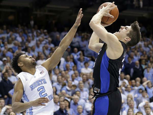 "<div class=""meta image-caption""><div class=""origin-logo origin-image none""><span>none</span></div><span class=""caption-text"">North Carolina's Joel Berry II (2) defends Duke's Grayson Allen. (Gerry Broome/AP)</span></div>"