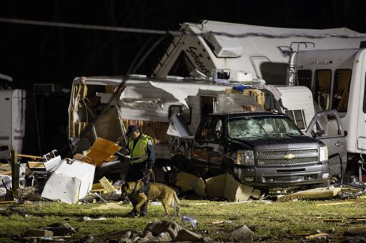 <div class='meta'><div class='origin-logo' data-origin='none'></div><span class='caption-text' data-credit=''>First responders search the remains of trailers and vehicles after a suspected tornado hit the Sugar Hill RV Park in Convent, La. (AP Photo/Max Becherer)</span></div>