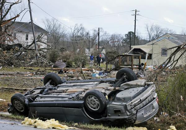 <div class='meta'><div class='origin-logo' data-origin='AP'></div><span class='caption-text' data-credit='Steve Helber'>An overturned car rest on a highway next to the foundation of a mobile home that was throw across the highway by a deadly storm that swept through Waverly, Va., Wednesday, Feb. 24.</span></div>