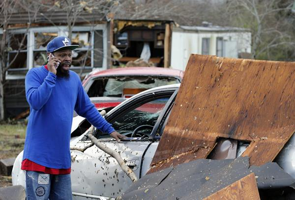 <div class='meta'><div class='origin-logo' data-origin='AP'></div><span class='caption-text' data-credit='Steve Helber'>Timothy Williams said he was in the car that he is standing next to when a storm swept through Waverly, Va.</span></div>