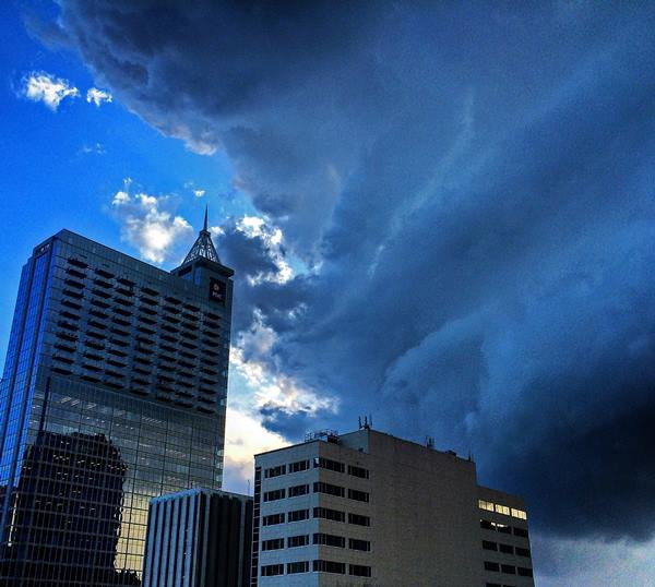 <div class='meta'><div class='origin-logo' data-origin='none'></div><span class='caption-text' data-credit='ABC11 Eyewitness/Jordan Petersen'>Early signs of the storm brewing over downtown Raleigh.</span></div>