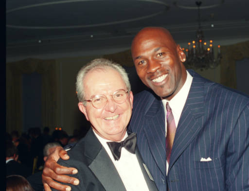 <div class='meta'><div class='origin-logo' data-origin='none'></div><span class='caption-text' data-credit='Credit: Hugh Morton Collection of Photographs and Films via UNC'>Michael Jordan embracing Woody Durham at the University Award ceremony for Dean Smith in Chapel Hill.</span></div>