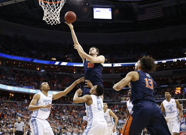 <div class='meta'><div class='origin-logo' data-origin='AP'></div><span class='caption-text' data-credit='Alex Brandon'>Virginia center Mike Tobey (10) shoots over North Carolina guard Nate Britt (0) during the first half</span></div>