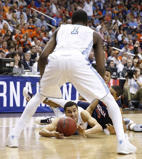 <div class='meta'><div class='origin-logo' data-origin='AP'></div><span class='caption-text' data-credit='Alex Brandon'>North Carolina guard Marcus Paige (5) passes the ball to North Carolina forward Theo Pinson (1) after a scrum on the floor with Virginia during the first half of an NCAA college ba</span></div>