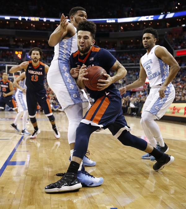 <div class='meta'><div class='origin-logo' data-origin='AP'></div><span class='caption-text' data-credit='Alex Brandon'>Virginia forward Anthony Gill (13) moves the ball against North Carolina forward Kennedy Meeks (3) during the first half of an NCAA college basketball game</span></div>