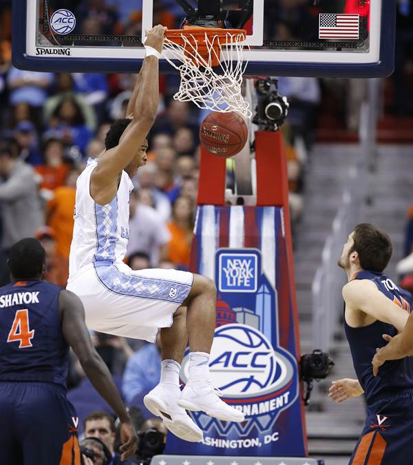 <div class='meta'><div class='origin-logo' data-origin='AP'></div><span class='caption-text' data-credit='Alex Brandon'>North Carolina forward Isaiah Hicks (4) dunks the ball against Virginia center Mike Tobey (10) during the first half of an NCAA college basketball game</span></div>