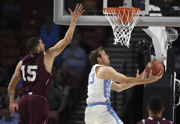<div class='meta'><div class='origin-logo' data-origin='AP'></div><span class='caption-text' data-credit='AP Photo/Rainier Ehrhardt'>North Carolina's Kanler Coker (13) drives past Stephan Bennett (15) during the second half in a first-round game of the NCAA men's college basketball tournament</span></div>