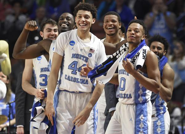 <div class='meta'><div class='origin-logo' data-origin='AP'></div><span class='caption-text' data-credit='AP Photo/Rainier Ehrhardt'>North Carolina players, from left, Luke Maye, Theo Pinson, Justin Jackson, Kennedy Meeks, Nate Britt and Joel Berry II react to a teammate's basket against Texas Southern</span></div>